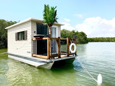Photo for A Peaceful Solar Houseboat at Anchor in the Keys