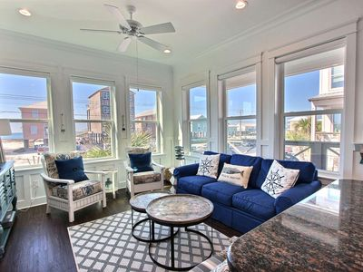 Photo for Adorable cottage with deeded beach access steps from the beach | Wifi, Pool, Pier on Little Lagoon