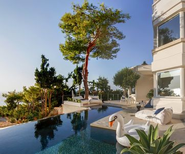 Photo for Luxurious hillside apartment overlooking the Sea and Chania with private pool.