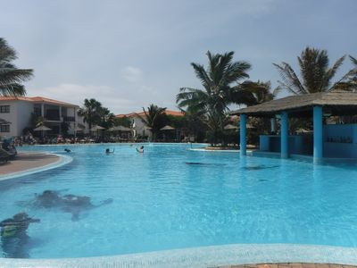 Photo for Ground floor pool side luxury 2 bed apartment in 5* resort - close to the beach