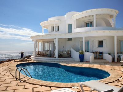Photo for 4 bedroom Villa, sleeps 8 in Punta Prima with Pool and WiFi