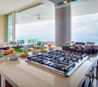 Kitchen next to large ocean front balcony