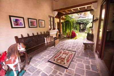 Once inside, you  are greeted by a beautiful interior garden.
