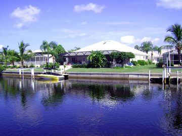 Stunning South-facing home waterfront home- private pool. boat dock, & bar