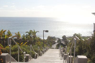 Steps down to beach. Funicular also available for easy transport down