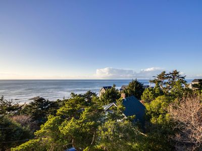 Photo for Upper-level studio with a balcony; dog-friendly and great ocean views!