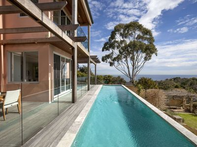 Photo for The ultimate in luxury holiday living with heated lap pool, open fireplace, water views, theatre room, ultra luxe interior. Heaven!