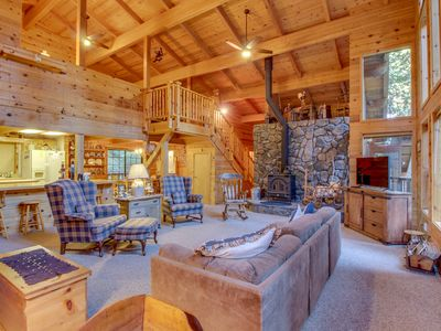 Photo for NEW LISTING! Cabin in the forest w/ wood stove and shared pool access!