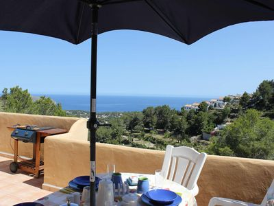 Photo for Tranquil setting. Large balcony. Exceptional sea, bay and mountain views.