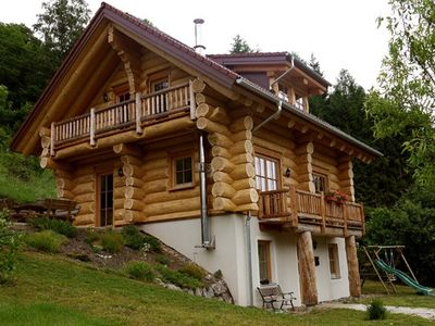 Photo for Stunning log cabin with sauna, hot tub, garden, WIFI and view of the Kreischberg