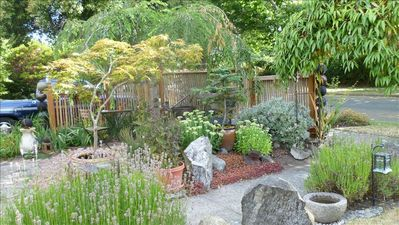 Walk off the street into a sitting garden - an oasis outside your front windows.
