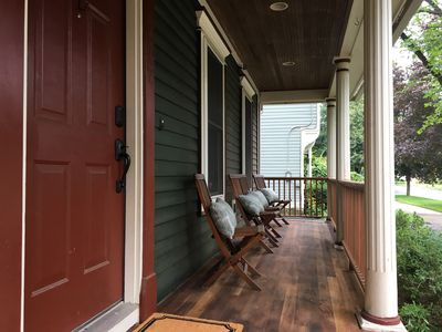 Comfortable teak chairs and great people-watching from the newly finished porch.