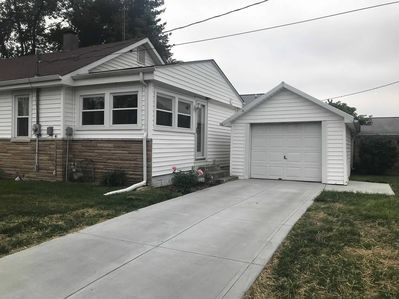 Driveway, garage, and main access (where lockbox) is to the home