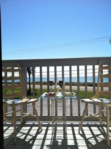 Enjoy breakfast on the balcony overlooking the beautiful beach