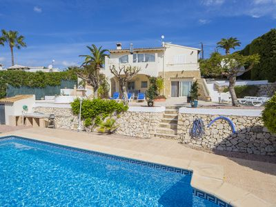 Photo for Beautiful 5 bed villa with 2 individual apartments, private garden and pool