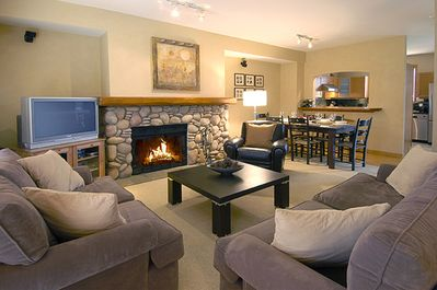 Spacious living/dining areas with wood burning fireplace for true mountain feel