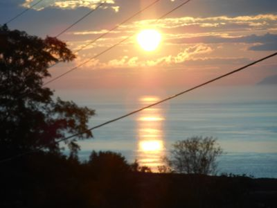 Sunset over the bay of Fundy. View from the porch.