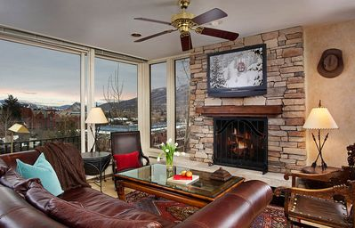 Living room with spectacular views of Aspen Mountain and downtown
