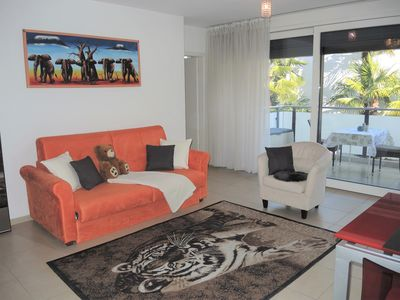 Photo for Modern holiday apartment with heated outdoor pool, well-kept garden and sunbathi