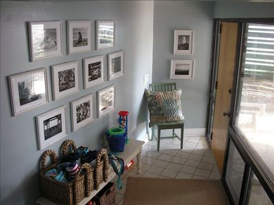 Double cart garage leads to foyer gallery.