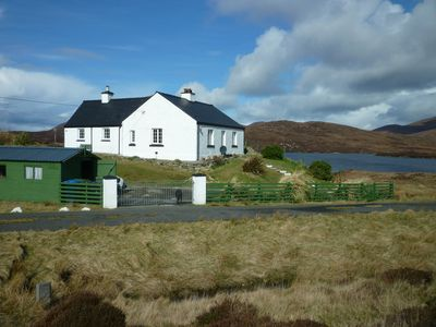 Photo for Secluded cottage with hill, loch and sea views.