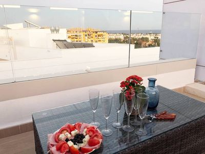 Photo for Modern penthouse by the beach, large roof terrace