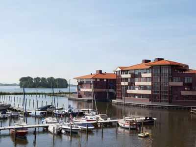 Photo for 4-person apartement in the holiday park Landal Waterparc Veluwemeer - on the water/recreation lake