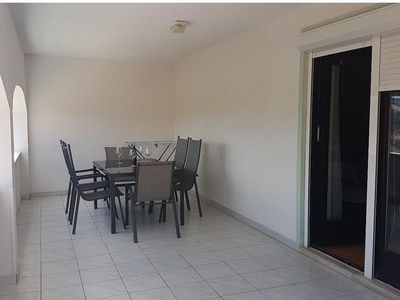 Photo for Two bedroom apartment with terrace Lopar (Rab) (A-10402-a)