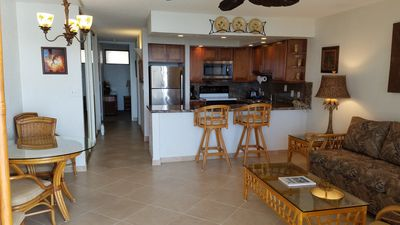 LIVING AND KITCHEN AREA WITH NEW TILE FLOORS