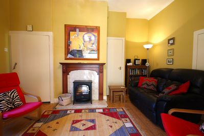 Cosy sitting room with TV and woodburning effect stove