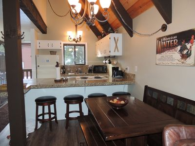 Dining Room and Kitchen with granite countertops. Seating for 10.