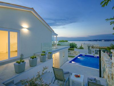 Photo for Modern holiday home set on its own enclosed property only 100 m from the beach