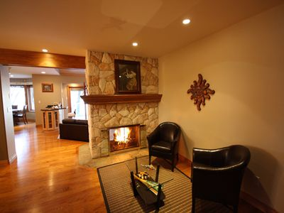 Open floor plan with cozy double-sided fireplace