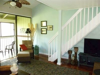 Screened in lanai and stairs to loft/bedroom.