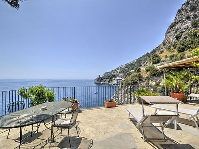 Photo for Villa Babila: A charming two-story villa set into the cliff, sheer above the sea and with direct access to the sea, with Free WI-FI.