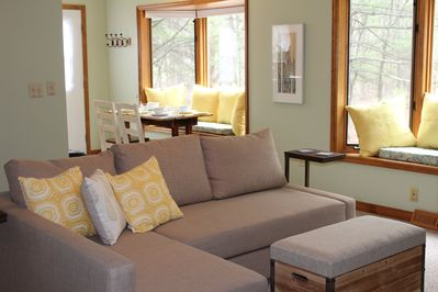 Bright and comfortable living area with a couch that becomes a full bed.