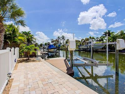 Photo for Waterfront home with a dock and heated pool.