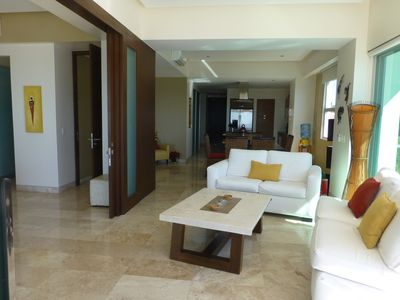 The condo features an open spacious plan, furnished for comfort and style.
