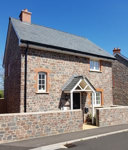 Photo for Two bed detached modern pet friendly cottage close to Dunster and Minehead