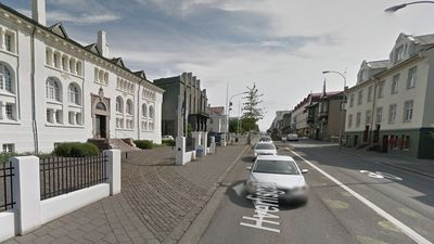 Street view. The third building on the right is a public parking building.