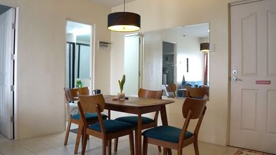 NEWLY-REFIT! COMPACT DINING table, wooden, sits four (4) persons, main door (on right) and bathroom (on background)
