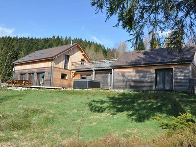 Photo for Gerardmer beautiful wooden chalet sleeps 16 230m2 Jacuzzi near ski track