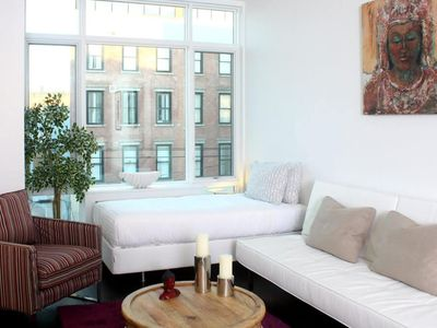 Photo for Enjoy various amenities: fitness center, yoga room, lounge, pool, & WiFi