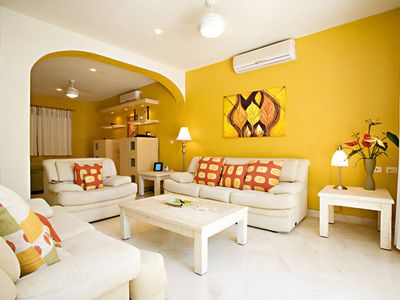 Bright and sunny living area with seating for up to 6 people.