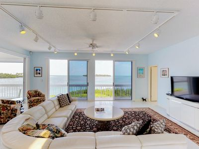 Photo for NEW LISTING! Luxurious waterfront home w/panoramic views, pool/spa & dock