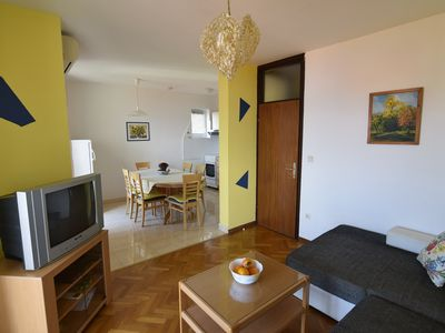 Photo for Holiday apartment with a balcony and sea view, just 300 metres from the beach