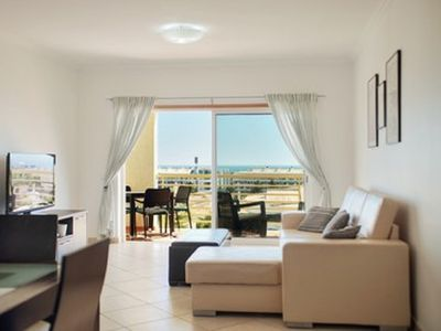 Photo for A Ver o Mar  sleeps 4, air con, wifi, pool, close to bars etc, sea views