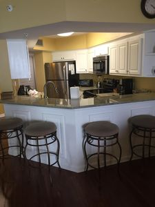Four bar stools for extra seating in dining room