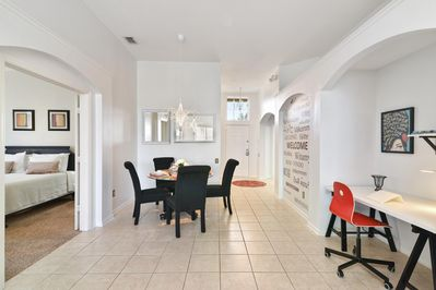 The entrance to this home features an modern office-like area.