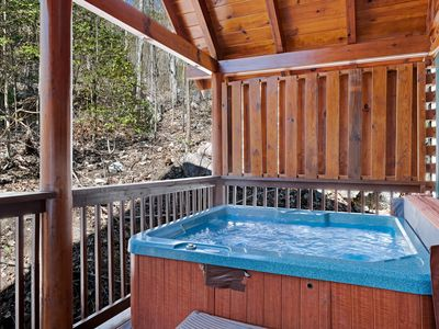 Photo for Tranquil woodland cabin w/ free WiFi, a private hot tub, & a shared pool